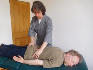 Patient receiving Bowen Technique Therapy at a clinic in Glasgow