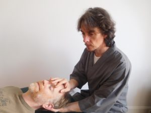 Steven Rutherford performing Craniosacral therapy in Glasgow on a patient in a clinic