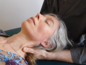patient neck and shoulders being treated by Steven Rutherford - Craniosacral therapy in Glasgow
